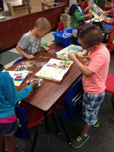 Ms. Sandy's kids beginning to sort and organize their LEGO kits.